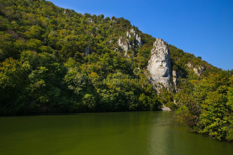 The statue of Decebal carved in the mountain. Decebal`s head carved in rock, Iron Gates Natural Park stock photography