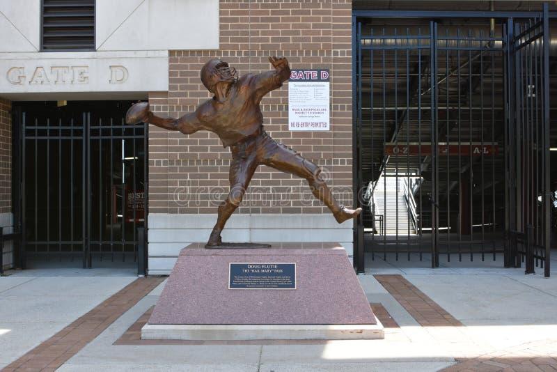 Doug Flutie Statue. The statue depicting BC QB Doug Flutie unloading his most famous pass to Gerard Phelan sits outside the entrance to Alumni Stadium stock image