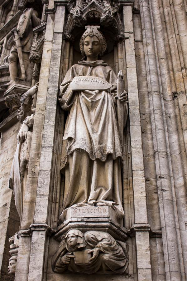 Statue detail in Grand Place. Bustling Brussels Grand-Place centers on its namesake square, towered over by the Gothic City Hall and ringed by opulent guild royalty free stock image