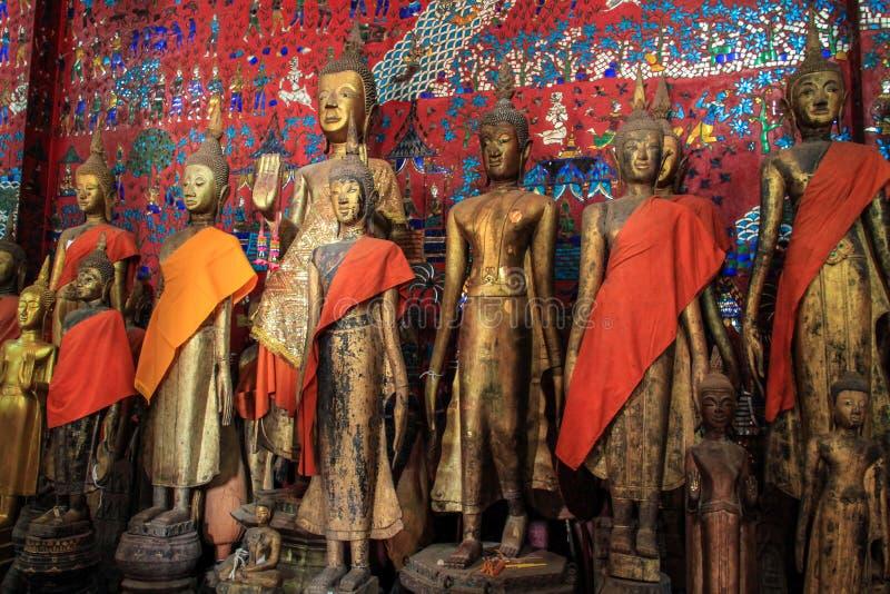 Statue di Buddha al tempio di Wat Xieng Thong in Luang Prabang fotografie stock