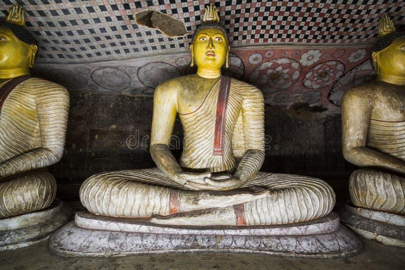 Statue di seduta del Buddhas fotografie stock libere da diritti