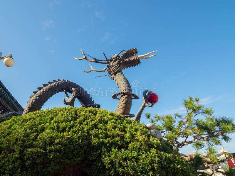 Statue of a dragon at Haedong Yonggungsa Temple. In Busan, South Korea stock photo