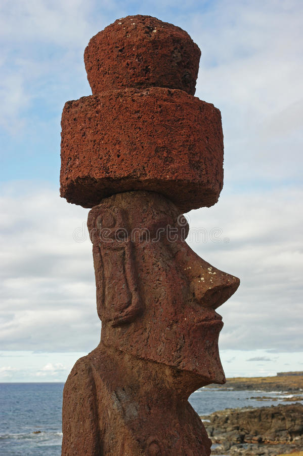 Statue at Easter island. Statue with topknot at sunrise in easter island stock photos