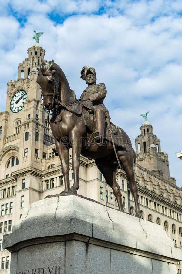 Statue of Edward VII outside the Royal Liver building. ENGLAND, LIVERPOOL - 15 NOV 2015: Statue of Edward VII outside the Royal Liver building royalty free stock photos