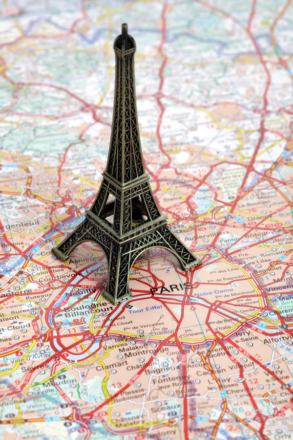 Statue of Eiffel Tower on map of Paris stock photo