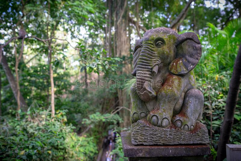 Statue of an elephant, Monkey forest, Ubud, Bali, Indonesia. Statue of an elephant, taken on an overcast afternoon, Monkey forest, Ubud, Bali, Indonesia royalty free stock images