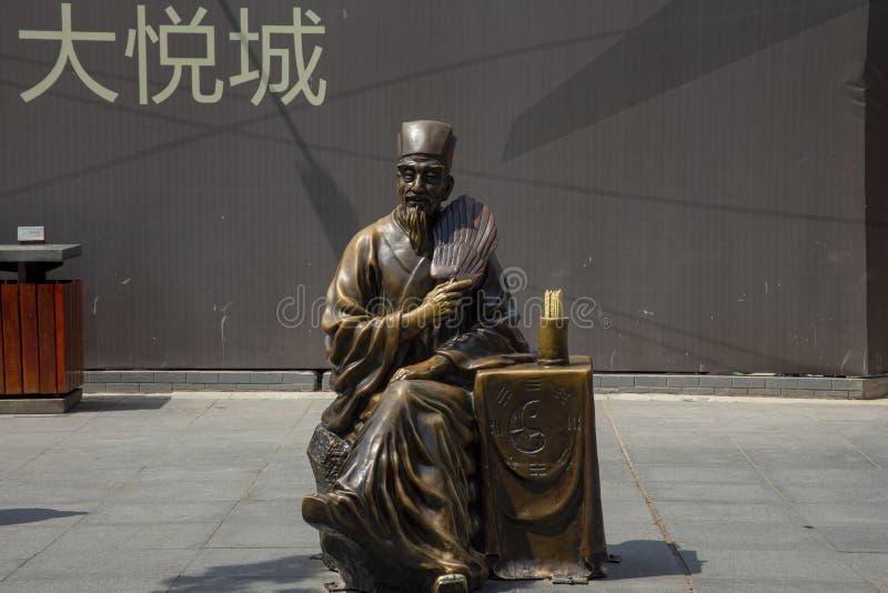 Statue en bronze de diseur de bonne aventure en parc public, Xian, Chine photo libre de droits