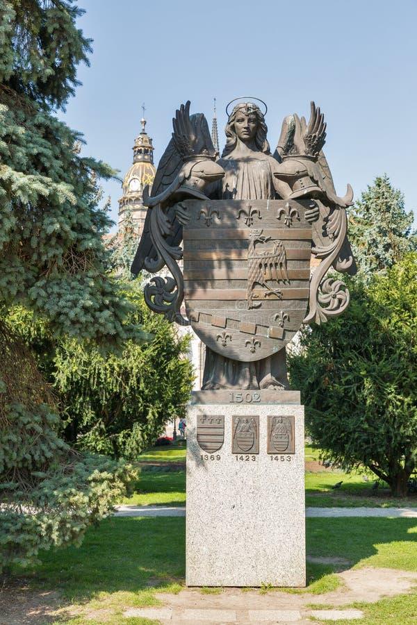 Statue en bronze du manteau de Kosice des bras, Slovaquie image stock