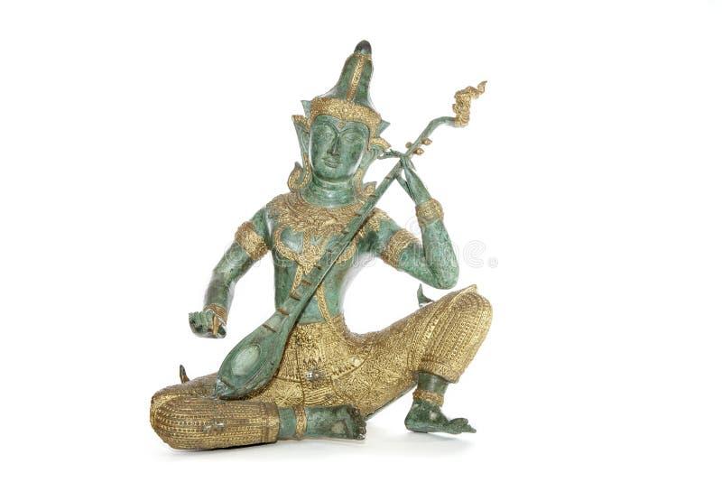 Statue en bronze thaïlandaise d'un musicien photo stock