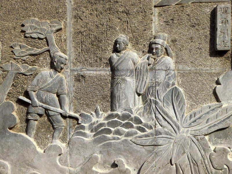 Statue en pierre antique de spéléologie images stock