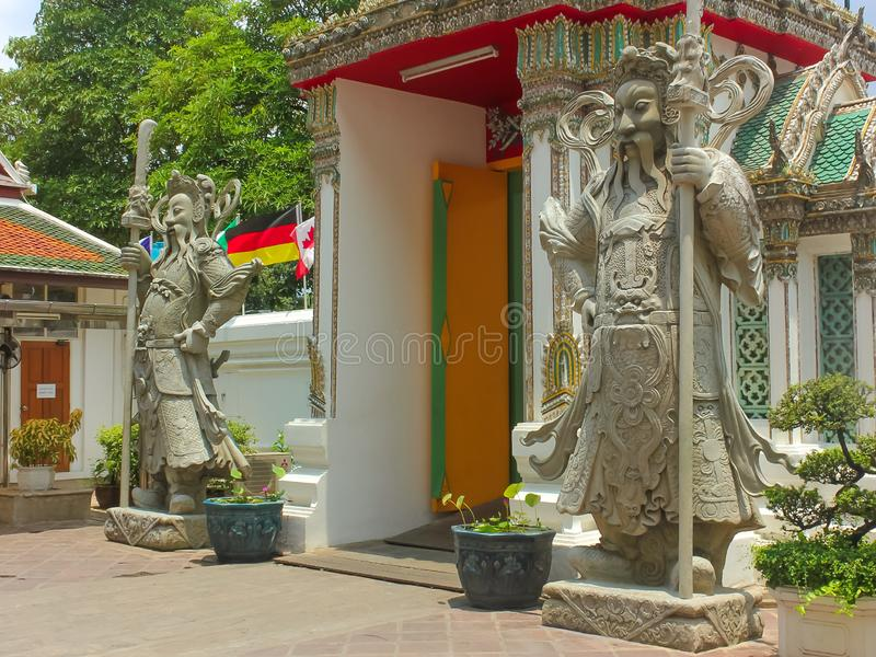 Statue en pierre chinoise de gardiens chez Wat Phra Kaew, temple d'Emerald Buddha, palais grand photo stock