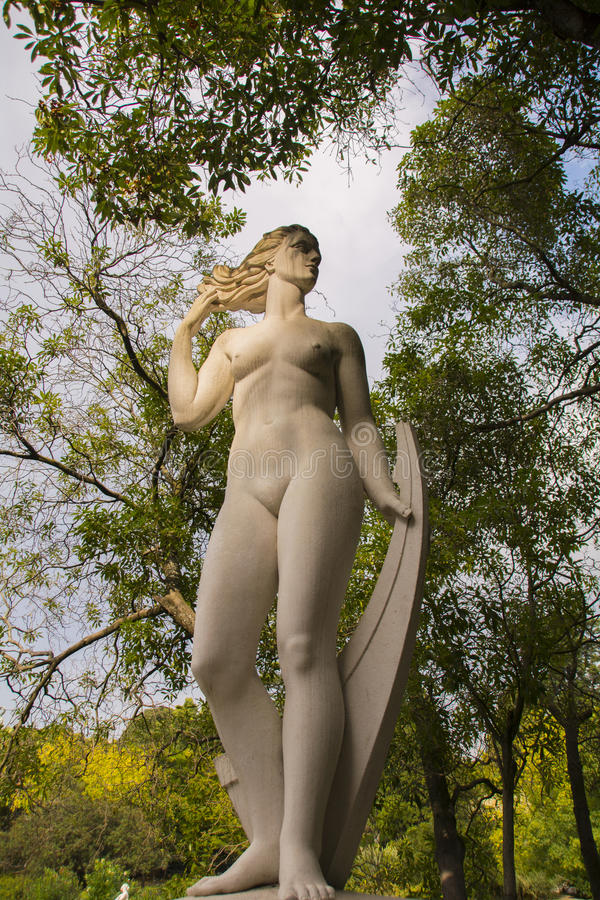 Statue in Estufa Fria. Water Maiden Statue located in the Estufa Fria.The Cold Greenhouse is a garden in a greenhouse located in the Parque Eduardo VII, Lisbon stock photography