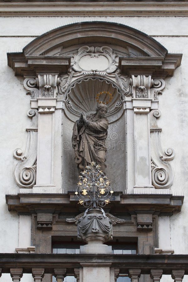 Statue on the facade of the church of St. Salvatore in Prague. Czech Republic royalty free stock photos