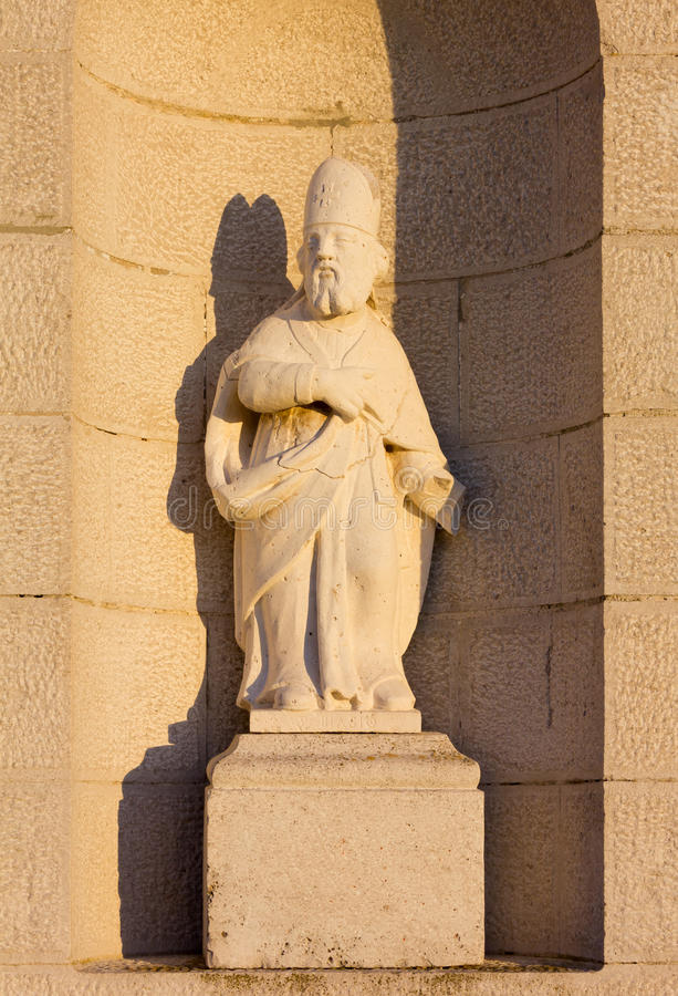 Statue on the Facade of a Country Church stock photos