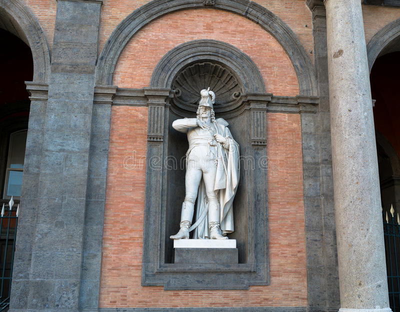 Statue on facade of Royal Palace Naples royalty free stock photography