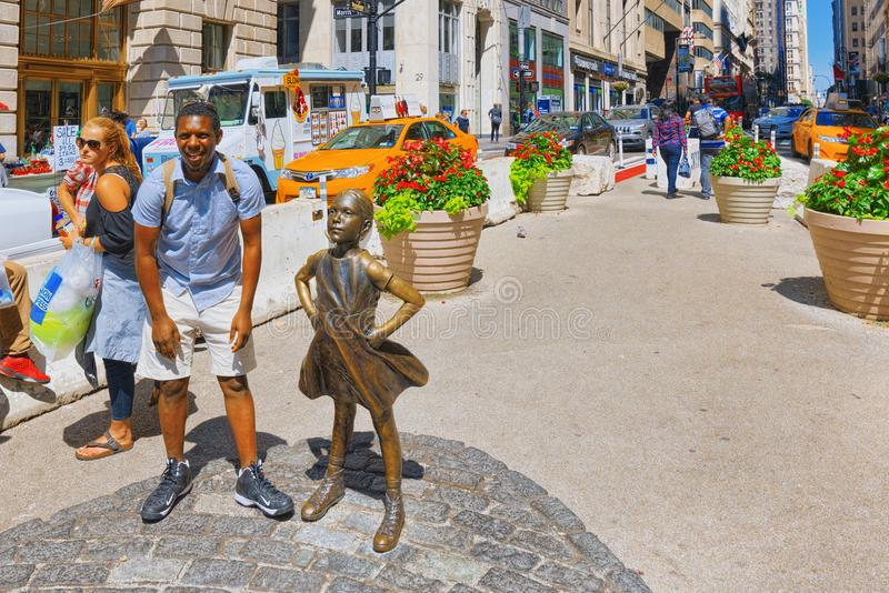 Statue of Fearless Girl on Broadway. Financial capital of America is New York City. stock photography