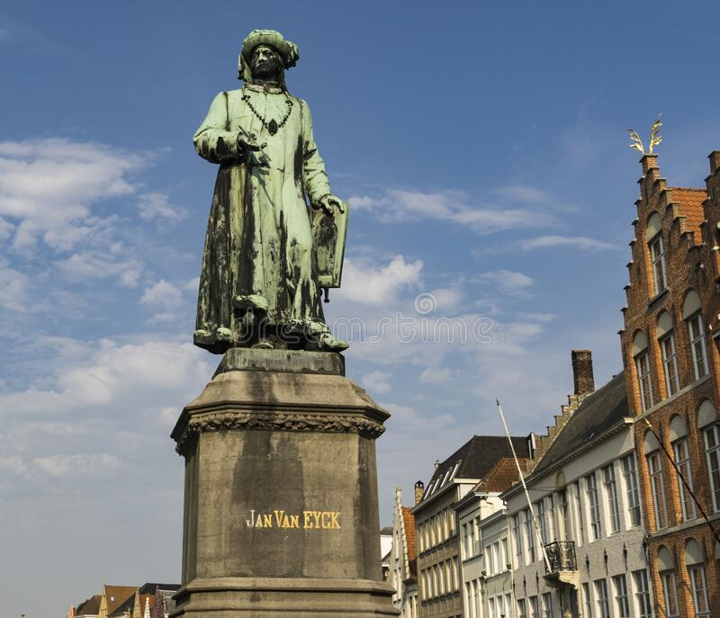 Statue of Flemish painter Jan Van Eyck on a street in Bruges stock photos