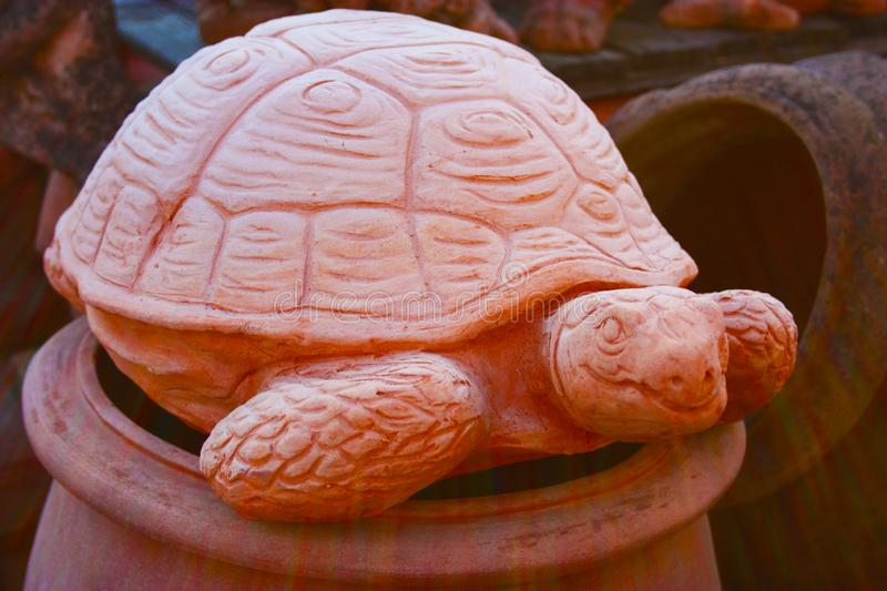 Statue in the form of a large earth tortoise or large tortoise. artistic work of a ceramic sculptor and worker. representation of. An animal by a craftsman stock photo