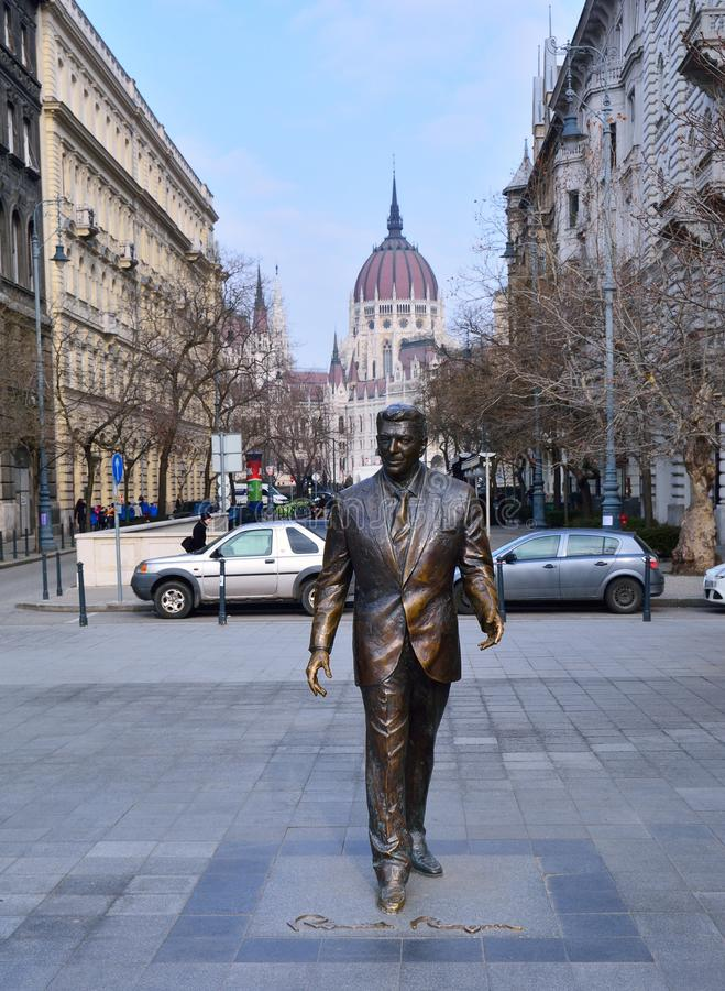 Statue of the former U.S. President Ronald Reagan on the background of Hungarian Parliament Building. royalty free stock image