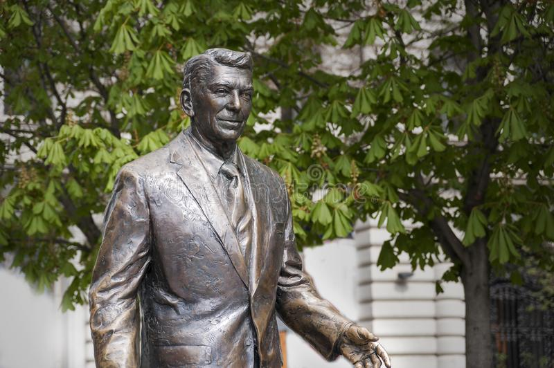 Statue of the former U.S. President Ronald Reagan. BUDAPEST, HUNGARY - APRIL 19, 2015: Statue of the former U.S. President Ronald Reagan on the background of stock images