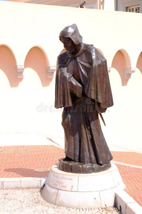 Statue of François Grimaldi in Monaco City. The Prince`s Palace of Monaco, built in 1191 as a Genoese fortress, is the official residence of the Sovereign royalty free stock photography