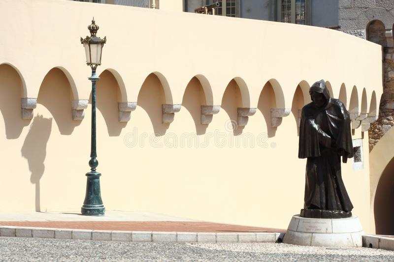 Statue of François Grimaldi, Monaco. The Prince`s Palace of Monaco, built in 1191 as a Genoese fortress, is the official residence of the Sovereign Prince of royalty free stock photo