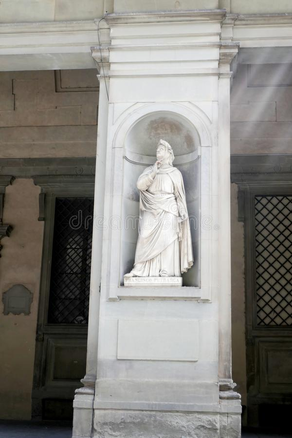 Statue of Francesco Petrarca in the niches of the Uffizi Gallery colonnade,. Florence stock photography