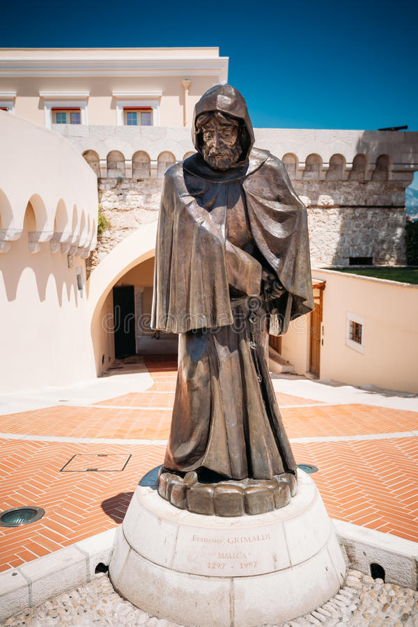 Statue of Francois Grimaldi disguised as a monk with a sword und. Monte-Carlo, Monaco - June 28, 2015: Statue of Francois Grimaldi disguised as a monk with a royalty free stock photography