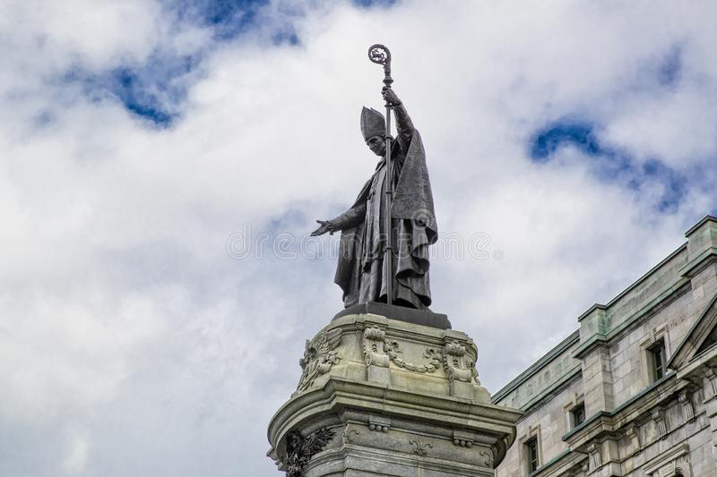 Statue of Francois Xavier de Montmorency Laval with beautiful blue cloudy sky in background. In Quebec City Canada stock images