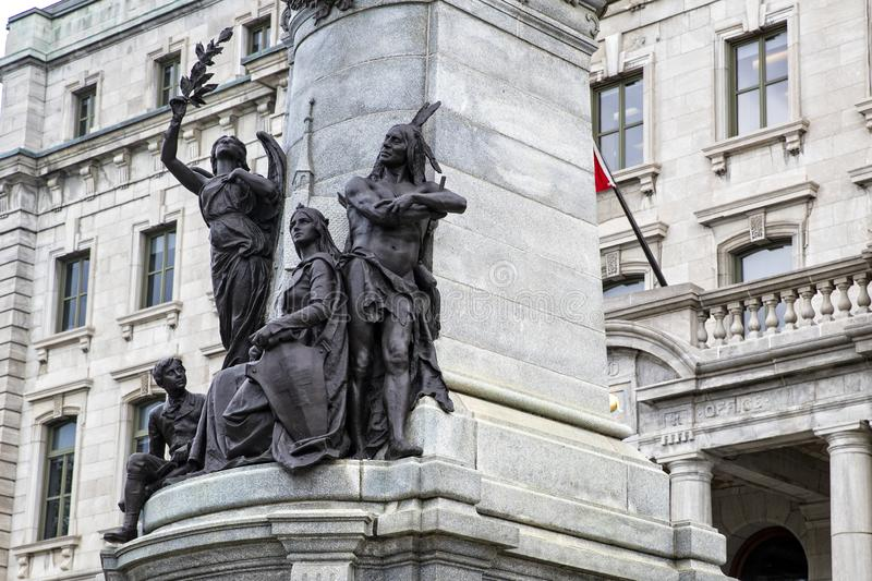 Statue of Francois Xavier de Montmorency Laval, with native indians and colonialist underneath. In Quebec City Canada stock photography