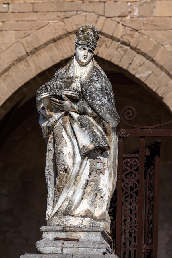Statue in front of the Cefalu Cathedral in Cefalu, Sicily, Italy stock photos