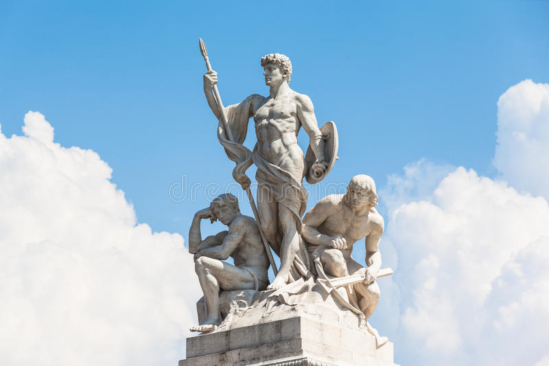 The statue in front of Monumento nazionale a Vittorio Emanuele I royalty free stock photos
