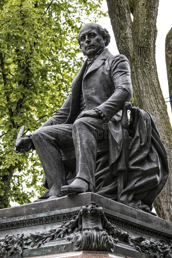 Statue of Garneau famous french historian in Quebec City , Canada. With green background stock image