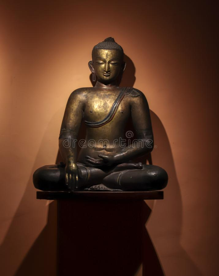 Statue of Gautam Buddha meditating royalty free stock image