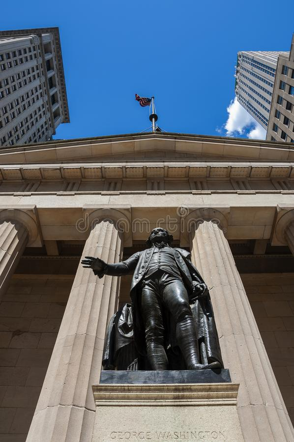 The statue of George Washington in front of the Federal Hall in Wall Street, New York City royalty free stock image
