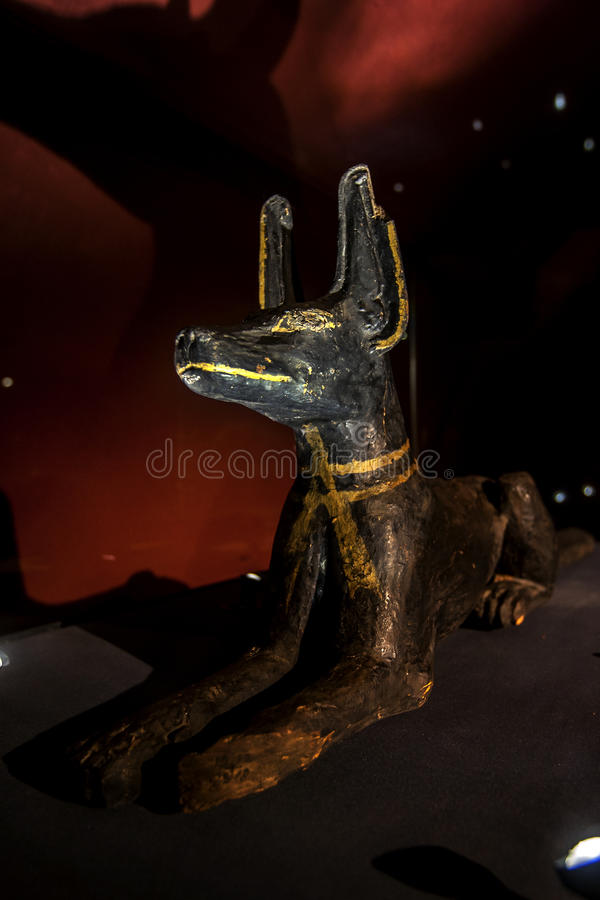 A statue of the god Anubis at the Alexandria Museum in Egypt. Anubis was an extremely ancient deity whose name appears in the oldest mastabas of the Old royalty free stock image