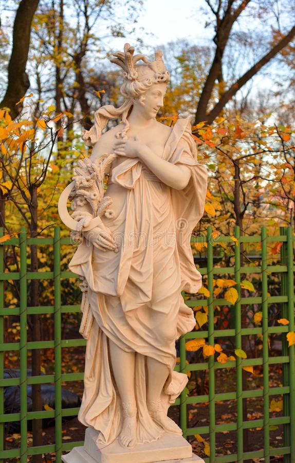 Statue of goddess Ceres in Summer Garden. Statue of goddess Ceres in Summer Garden at autumn evening, St.Petersburg, Russia. Roman goddess of harvest and royalty free stock image