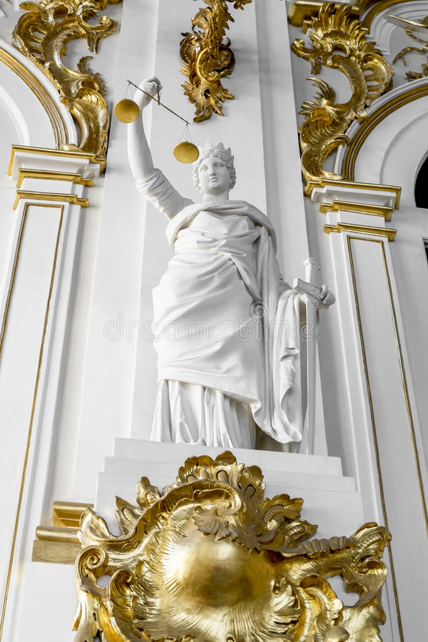 The statue of the Goddess of justice on the Jordan staircase in. 17 April 2016. Saint-Petersburg. The statue of the Goddess of justice on the Jordan staircase in stock photo
