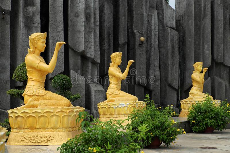 Statue of goddess of luck at Suoi Tien. HO CHI MINH CITY, VIET NAM- JUNE 1, 2017: Group of yellow statue of goddess of luck at Suoi Tien tourist area, place for stock image