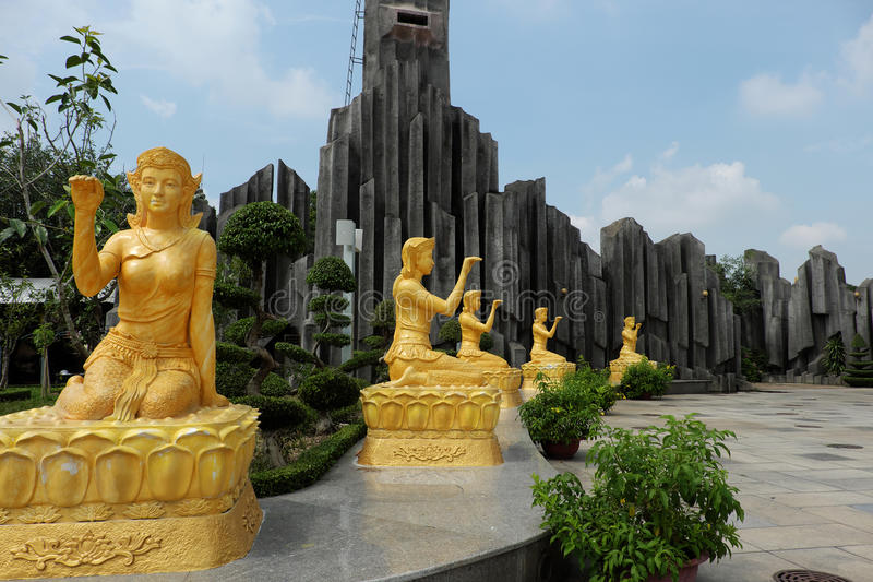 Statue of goddess of luck at Suoi Tien. HO CHI MINH CITY, VIET NAM- JUNE 1, 2017: Group of yellow statue of goddess of luck at Suoi Tien tourist area, place for stock photos