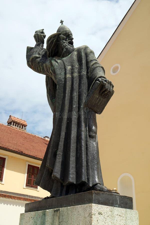 Statue of Gregory of Nin, medieval Croatian bishop of Nin in front of Saint John the Baptist church in Varazdin, Croatia royalty free stock image