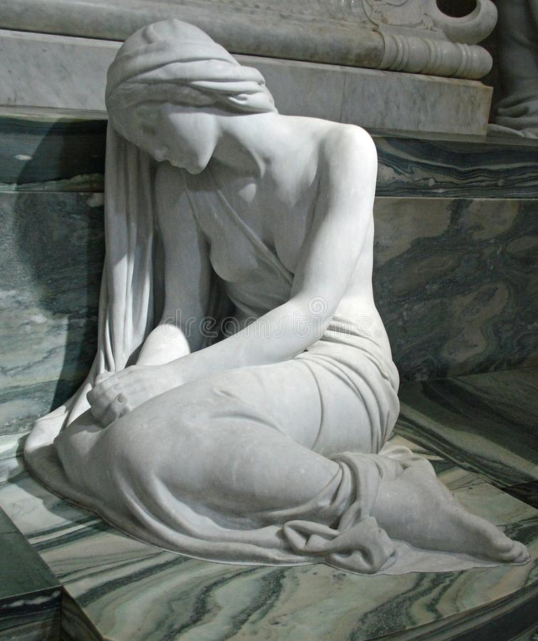 Statue of grief at Roskilde Cathedral. By Edvard Eriksen. Same sculpturer and model as the little mermaid in copenhagen Beside the double double sarcophagus of royalty free stock photos