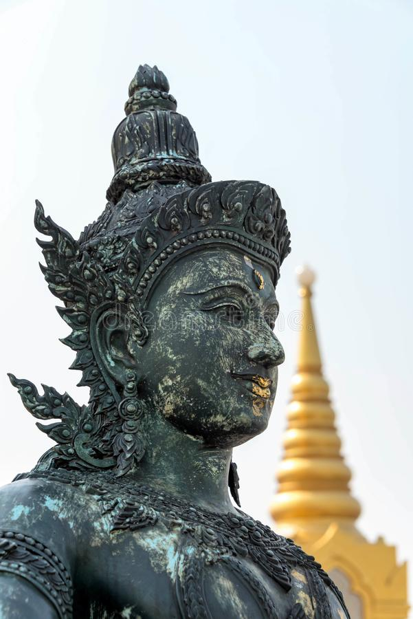 Stoic Worship. Statue guarding a Buddhist temple in Thailand royalty free stock photos