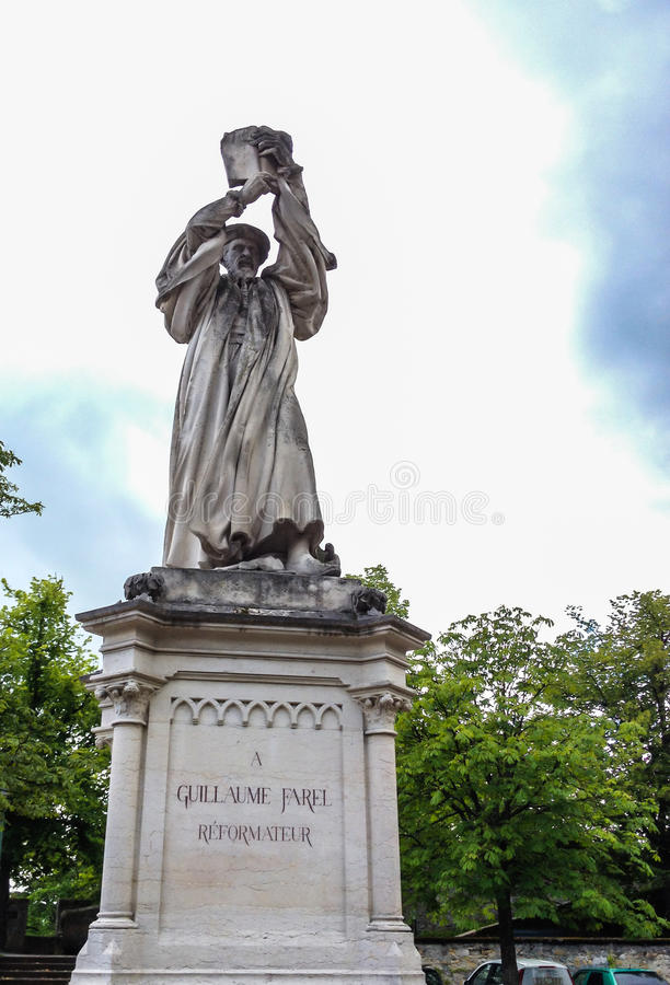Statue of Guillaume Farel in Neuchatel. a French evangelist, and a founder of the Reformed Church in the cantons of Neuchatel. Berne, Geneva, and Vaud in stock image
