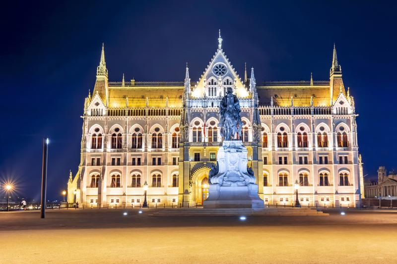Statue of Gyula Andrassy in front of Hungarian parliament at night, Budapest, Hungary royalty free stock photography