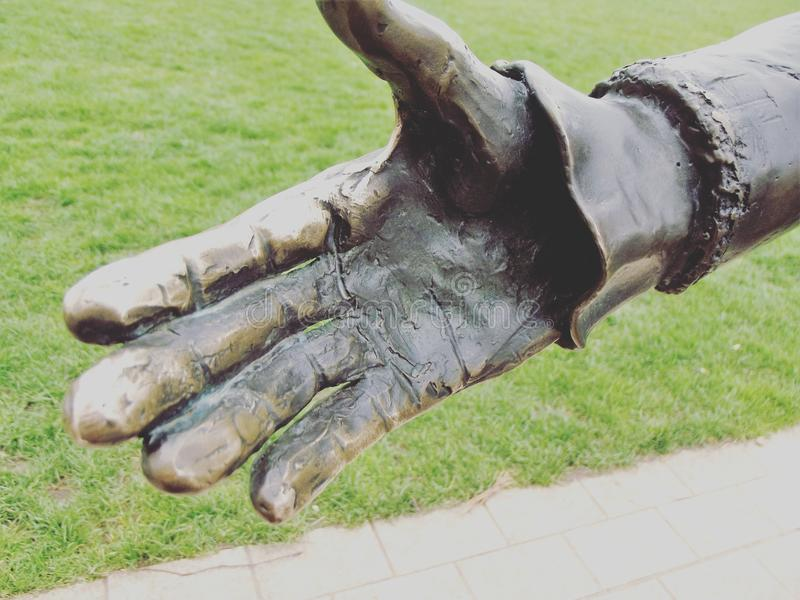 Statue. Hand of a William Shakespeare statue that has rusted stock photo