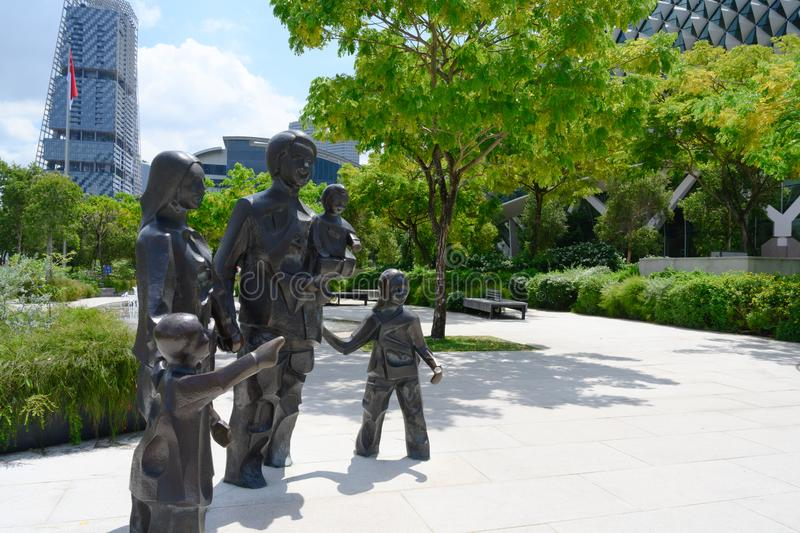 Statue Happy Family of Five in Singapore, 2012,. The Statue Happy Family of Five stands in the Centre`s Forecourt Garden, a place for families and friends to stock photo