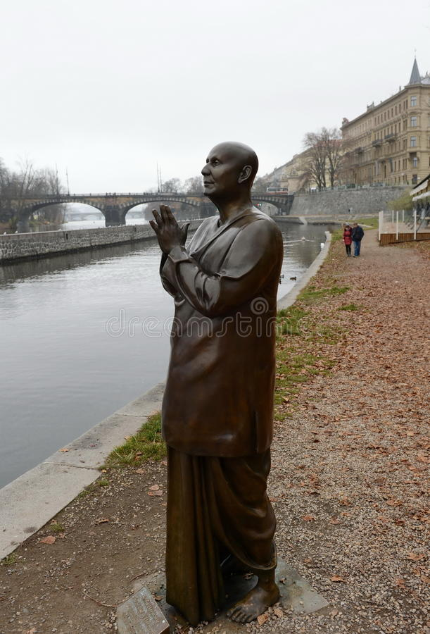 The statue of `Harmony or sculpture Praying` Socha Harmonie erected in honor of the famous Indian philosopher-humanist, a preach stock photos