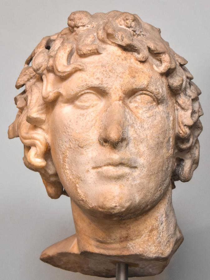 Statue of the Head of Alexander the Great. London, United Kingdom museum. A plaster statue of the Head of Alexander the Great on display stock image
