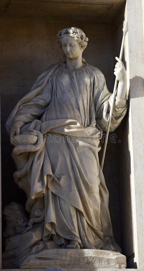 Statue of Health at Trevi Fountain stock photo